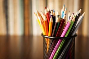 Wire desk tidy full of coloured pencils